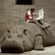 Hope Hippo, 2005<br>mud, whistle, daily newspaper, live person<br>Approximately 192x72x60in<br>Photo courtesy of the 51st Venice Biennale<br><br>Allora & Calzadilla